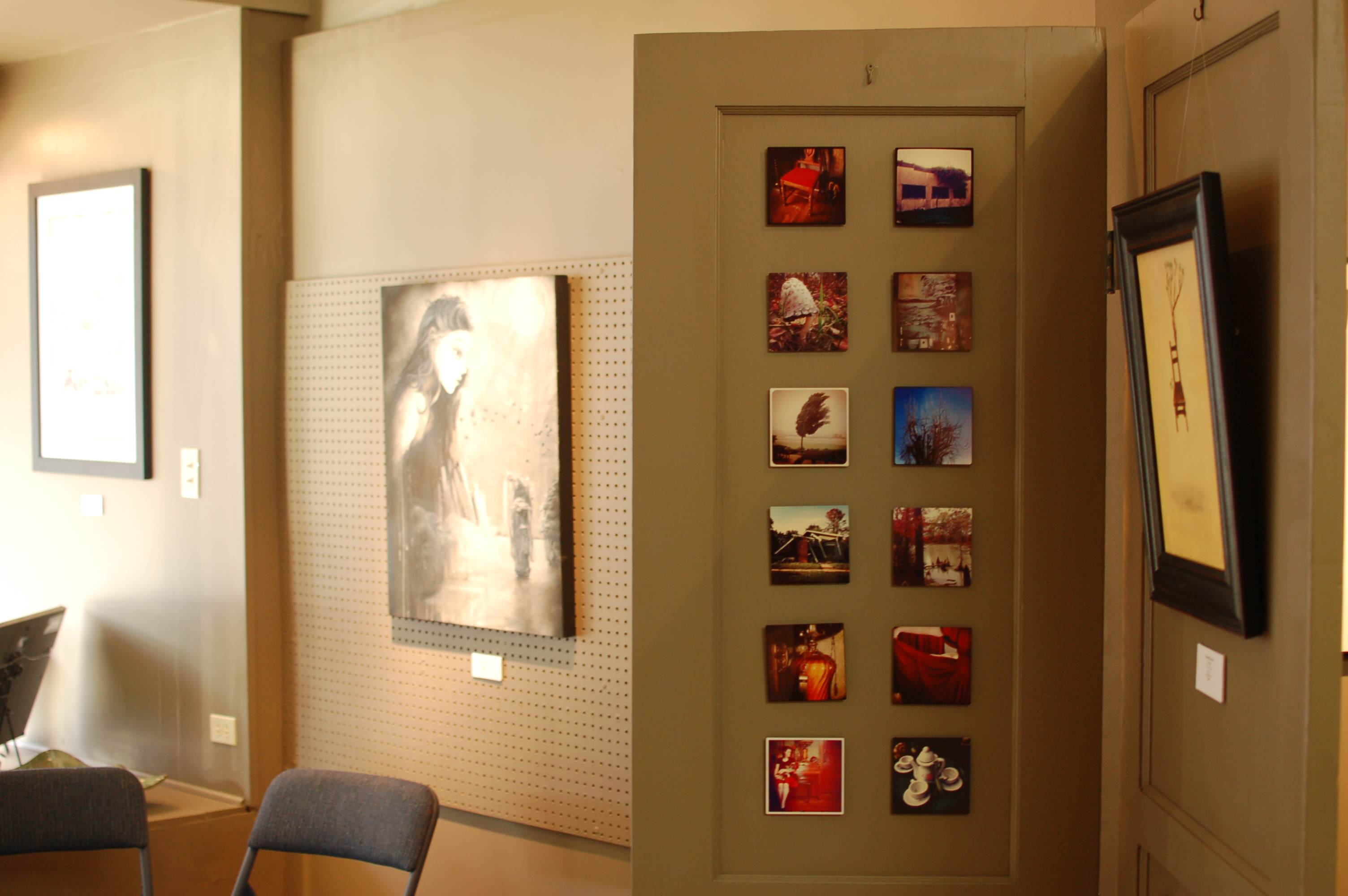 Near the window, paintings and photography