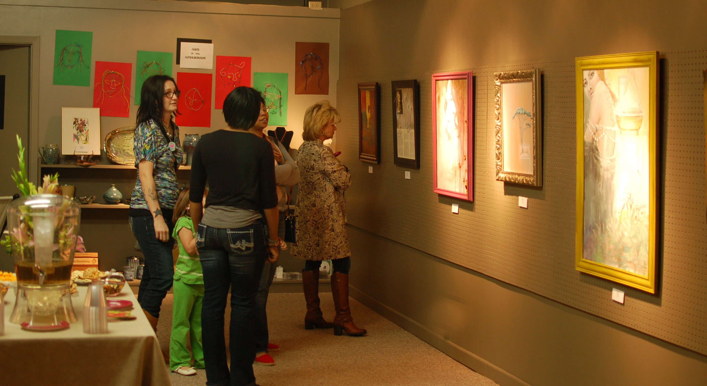 Guests looking at my paintings